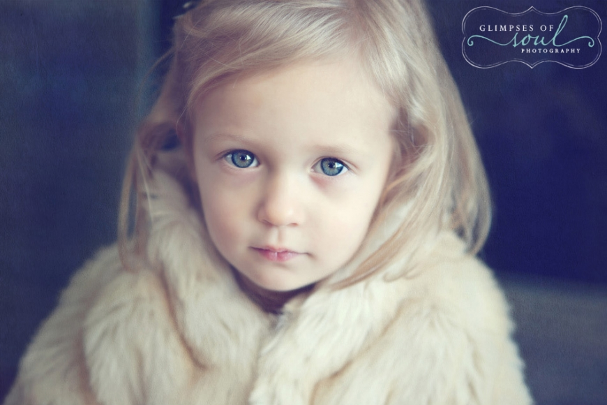 blue eyed girl in fur