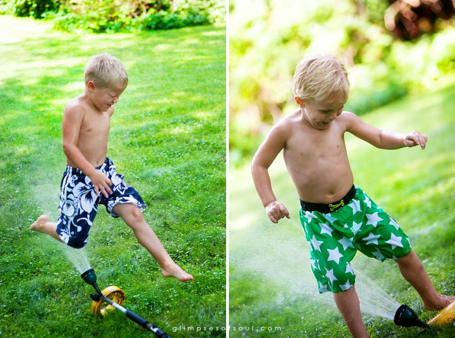 little boys running through sprinkler