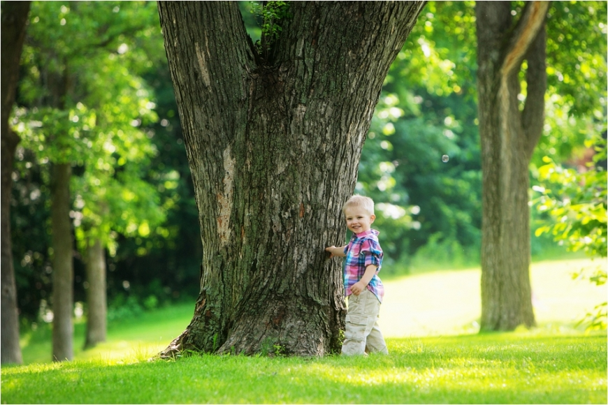 little boy by tree