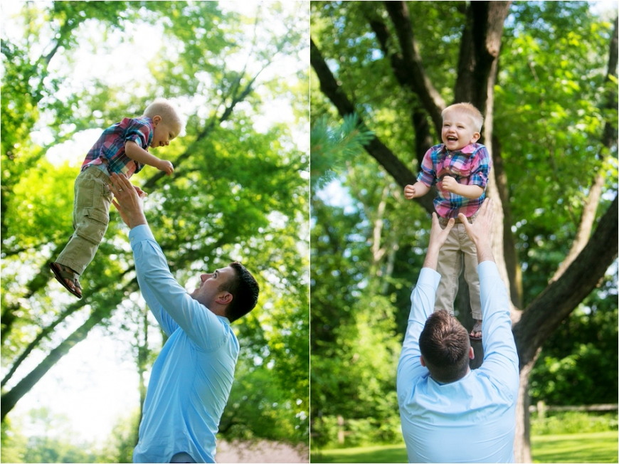 dad tossing son in air