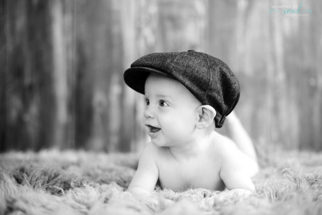 black and white baby in newsboy