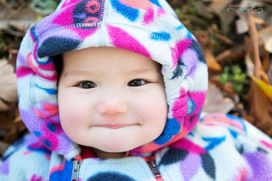 smiling baby in snowsuit