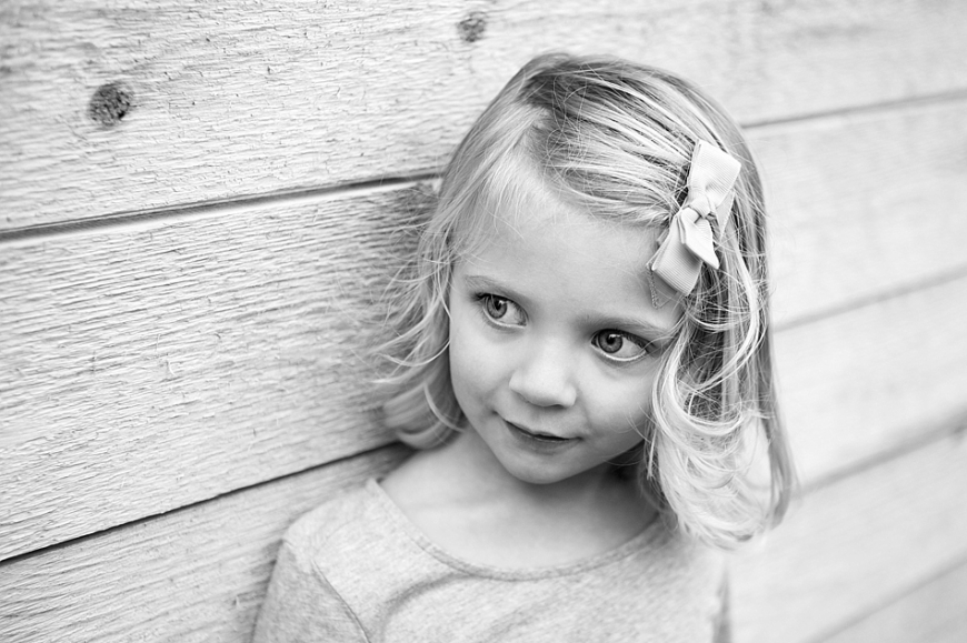 black and white little girl looking away