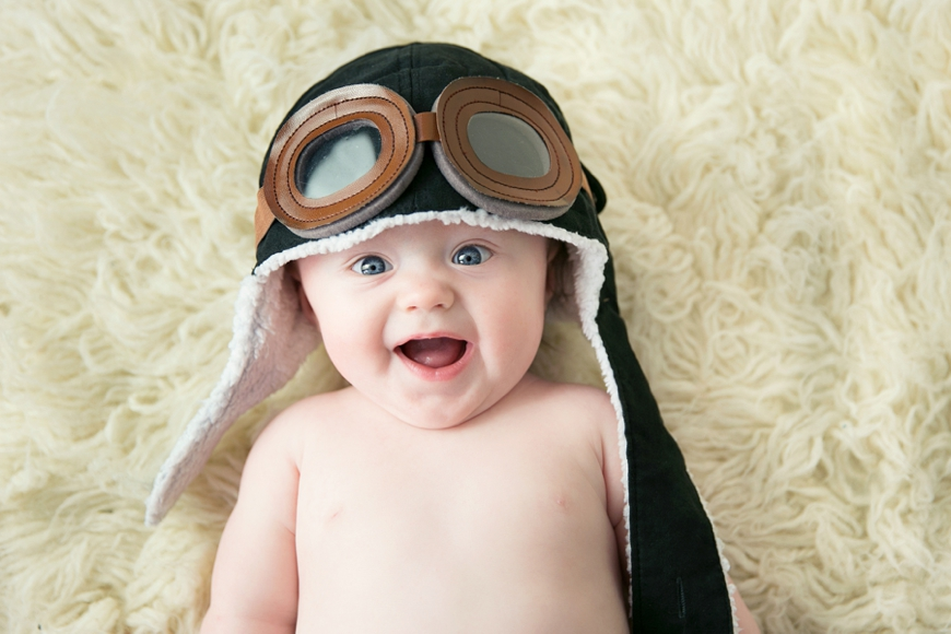 baby in aviator hat