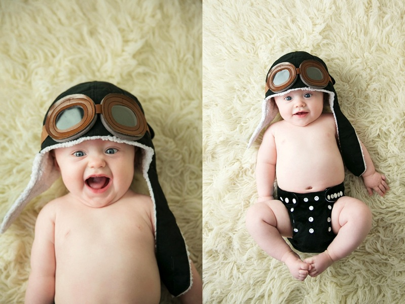 smiling baby in aviator hat