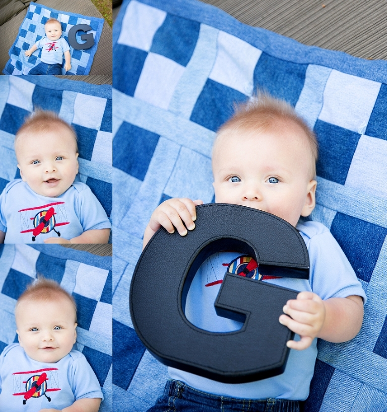 baby on quilt with letter