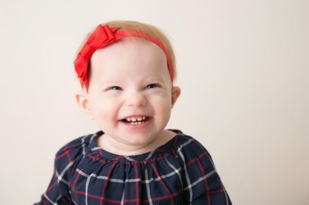 one year old in red headband