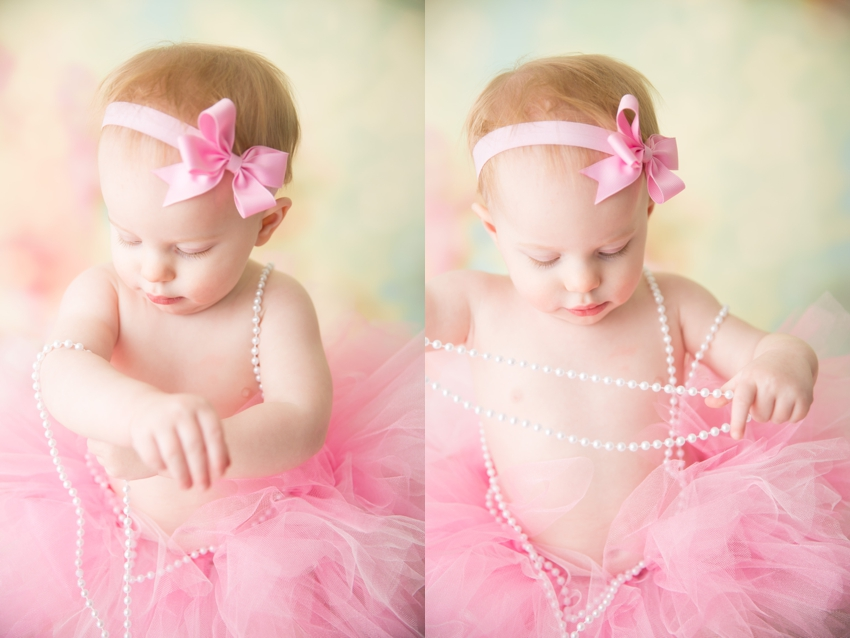 baby in pink with pearls